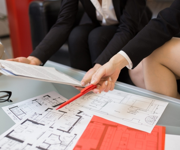 Table with House Plans in Real Estate Agency